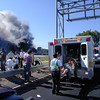 010911-N-6157F-003<br /> Arlington, Virginia (Sept. 11, 2001) -- Medical personnel load wounded into an ambulance at the first medical triage area set up outside the Pentagon after a hijacked commercial airliner crashed into the southwest corner of the building.  U.S. Navy Photo by Journalist 1st Class Mark D. Faram (Released)