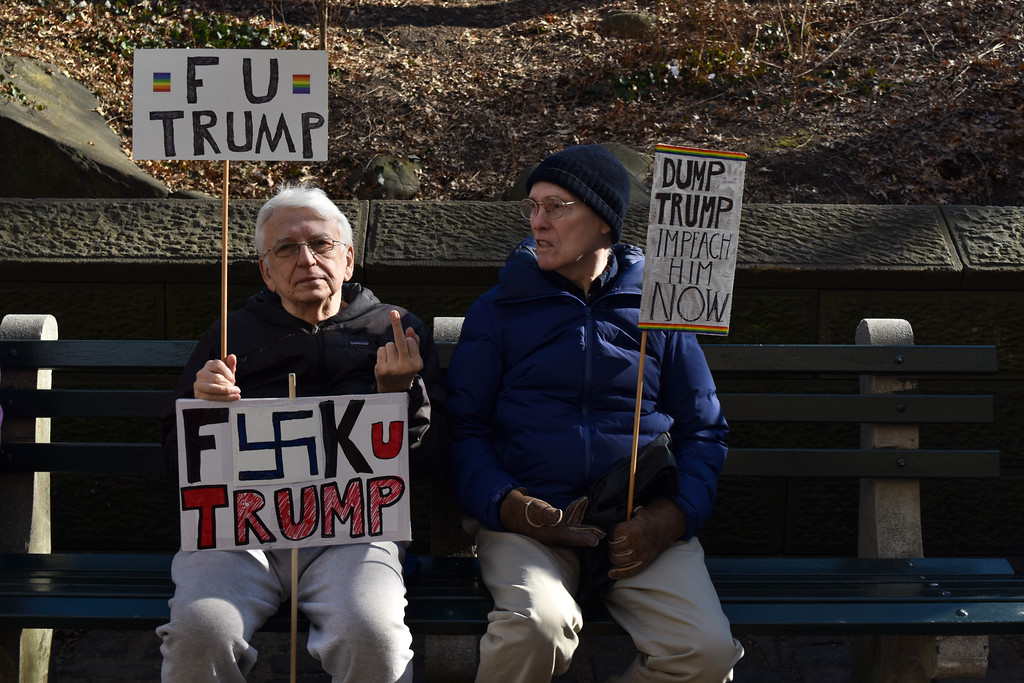 Marchers taking a break on a bench.