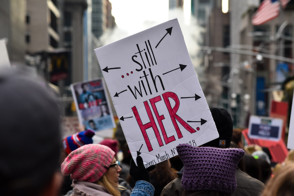 "The popular phrase ""still with her"" could be seen on many signs during the day."