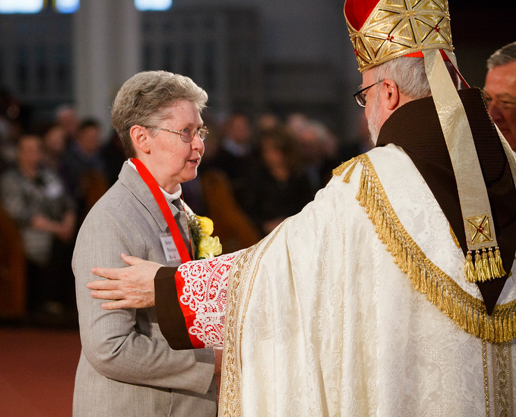 Cardinal Seán P. O'Malley presents the 2014 Cheverus Award Medals for service to the Church to 116 recipients at a Vespers Service at the Cathedral of the Holy Cross Nov. 23, 2014. Afterward, the cardinal joined the recipients and their families at a reception in neighboring Cathedral High School.<br /> Pilot photo/ Gregory L. Tracy