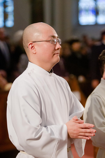 Ordination of transitional Deacons Jeffrey Archer, Steven Clemence, Peter DeFazio, George Fitzsimmons, Kevin Hickey, Karlo Hocurscak, Mark Storey, Lawrence Tocci and Jiwon Yoon Jan. 18, 2014 at the Cathedral of the Holy Cross.<br /> Pilot photo by Gregory L. Tracy