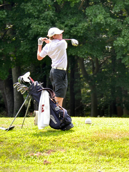 Junior lefty Dan Frodigh of Westwood finishes in classic form as he sends one high and deep down the center of the fairway.<br /> (Pilot photo/ Courtesy Rick Mattulina)
