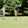 Junior Richard Miller of Hingham lines up a short putt. Richard later went on to drive pin-high on the 312-yard 18th hole and sink his putt for an eagle.<br /> (Pilot photo/ Courtesy Rick Mattulina)