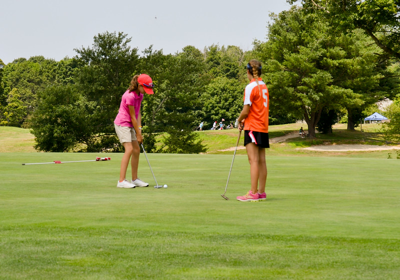 Girls Junior Champion Jillian Barend of North Attleboro sends a putt cupward as Finalist Angelina Crovo of Duxbury looks on. (Pilot photo/ Courtesy Rick Mattulina