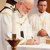 Bishops-elect Robert Reed and Mark O'Connell take their Oath of Fidelity before Cardinal O'Malley during a Mass broadcast live on CatholicTV Aug. 12, 2016.  During the Mass, the cardinal also blessed the insignia — crossiers, mitres and rings — that the bishops will receive at their ordination.<br /> Pilot photo/ Gregory L. Tracy