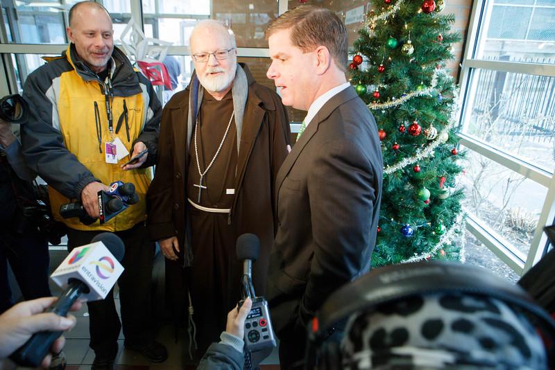 Cardinal Seán P. O'Malley, Boston Mayor-elect Marty Walsh and Sen. Edward Markey serve meals at Pine Street Inn Dec. 24, 2013. Pilot photo by Gregory L. Tracy