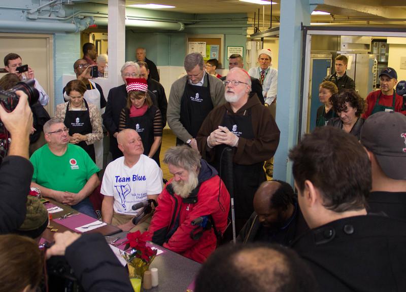 Cardinal Seán P. O'Malley visits Pine Street Inn homeless shelter in Boston Dec. 24, 2104.<br /> Pilot photo/ Christopher S. Pineo