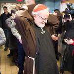 Cardinal's Christmas Eve visit to Pine Street Inn