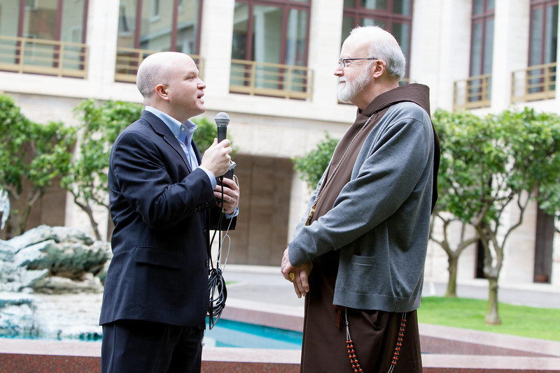 Cardinal Sean O'Malley conduct an interview with Scot Landry, head of the Archdiocese of Boston's Catholic Media Secretariat in the courtyard of the Pontifical North American College March 5, 2013.<br /> <br /> Pilot photo by Gregory L.  Tracy