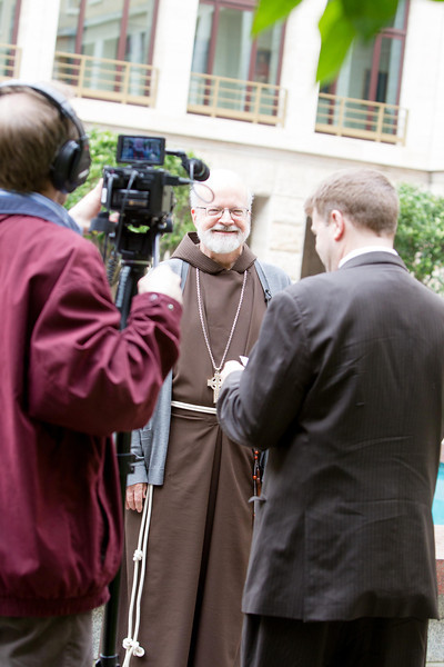 Cardinal Sean P.  O'Malley speaks with Jay Fadden of the CatholicTV Network in the courtyard of the Pontifical North American College March 5, 2013.<br /> <br /> Pilot photo by Gregory L.  Tracy