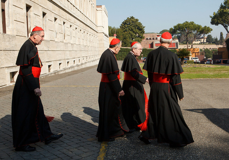 Cardinals Roger Mahony, Daniel DiNardo, Justin Rigali and Donald Wuerl leave the Pontifical North American College in Rome on their way to a final meeting with Pope Benedict XVI February 28, 2013.<br /> Pilot photo/Gregory L. Tracy