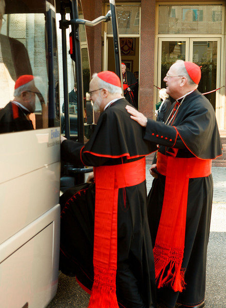 Boston Cardinal Sean O'Malley and New York Cardinal Timothy Dolan board a bus at the Pontifical North American College in Rome on their way to a final meeting with Pope Benedict XVI February 28, 2013.<br /> Pilot photo/Gregory L. Tracy