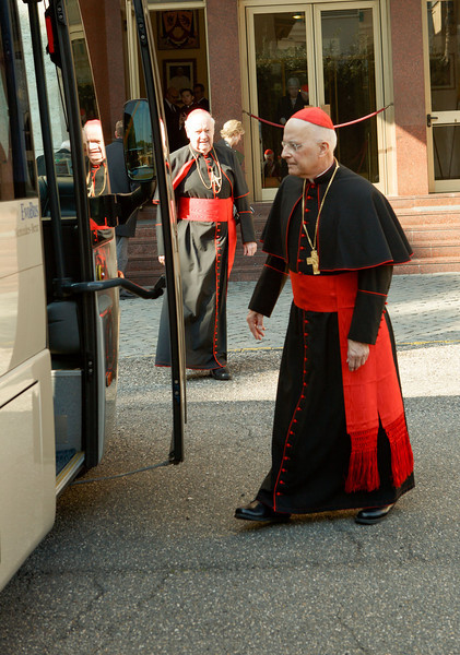 Cardinals Francis George and Edward Egan board a bus at Pontifical North American College in Rome on their way to a final meeting with Pope Benedict XVI February 28, 2013.<br /> Pilot photo/Gregory L. Tracy