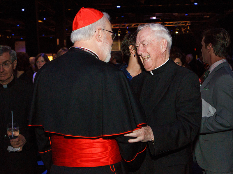 Cardinal Sean P. O'Malley greet guests at the Fifth Annual Celebration of the Priesthood Dinner, held Sept. 26, 2013 at the Seaport World Trade Center in Boston. <br /> Pilot photo/ Gregory L. Tracy