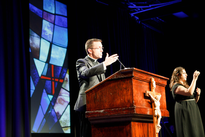 Father Robert Reed served as the evening's emcee at the Fifth Annual Celebration of the Priesthood Dinner, held Sept. 26, 2013 at the Seaport World Trade Center in Boston. <br /> Pilot photo/ Gregory L. Tracy
