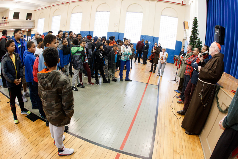 Cardinal O'Malley visits the Teen Center and St. Peter's in Dorchester Saturday, Dec. 24, 2016. In partnership with the Menino family, Catholic Charities of Boston distributed Christmas gifts to nearly 400 children and families in need.<br /> Pilot photo/ Gregory L. Tracy