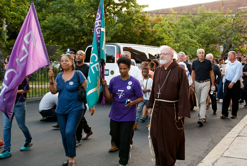 Cardinal O'Malley, priests and other religious leaders participate in a walk for peace in Dorchester, July 11, 2017.<br /> Pilot photo/ Mark Labbe