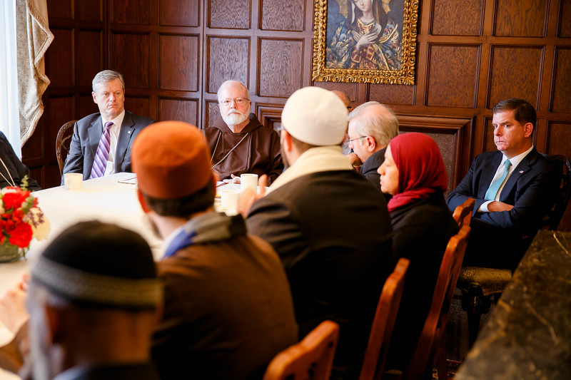 Gov. Charlie Baker, Cardinal Sean O'Malley and Boston Mayor Martin Walsh listen to remarks by  Imam Yasir Fahmy of the Islamic Society of Boston Cultural Center at a gathering hosted by Cardinal O'Malley to bring Boston-area Muslim community leaders together with representatives of the local Catholic and Greek Orthodox Churches and government officials, including Gov. Baker, Mayor Walsh and Boston Police Commissioner William Evans, at the rectory of the Cathedral of the Holy Cross Feb. 2, 2017.<br /> Pilot photo/ Gregory L. Tracy