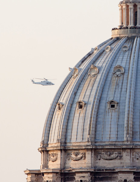 The helicopter carrying Pope Benedict passes the dome of St. Peter's Basilica February 28.  Pilot photo/Gregory L.  Tracy
