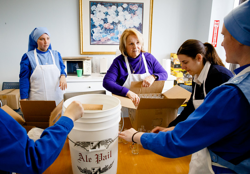 Daughters of Mary of Nazareth and Sister Disciples of the Divine Master along with the staff of the Cardinal's Office prepare the Holy Oils to be blessed during Holy Week, March 25, 2019. (Pilot photo/ Gregory L. Tracy)