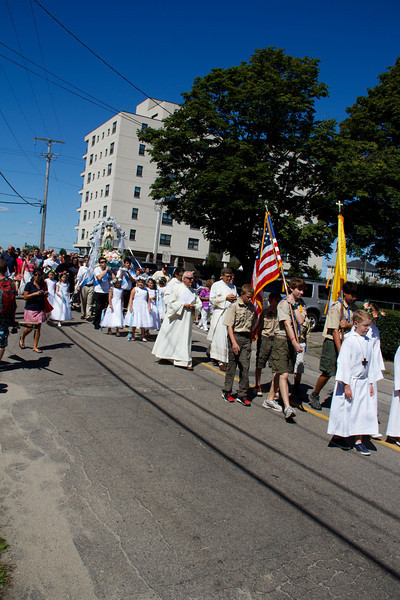 St. Mary of the Assumption at St. Ann's Church in Hull celebrates their parish feast Sunday Aug. 11, 2013 with a procession that began with a decorated statue of the Virgin Mary arriving by boat at the town's A Street Pier.  The statute was then carried though the town streets to the church for the Mass.<br /> Pilot photo/ Christopher S. Pineo