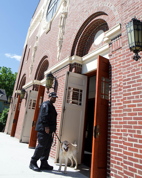 St. Ann Church in Dorchester is swept by bomb sniffing dogs prior to the June 9, 2013 birthday memorial Mass for Boston Marathon bombing victim Martin Richard. Photo by Gregory L. Tracy, The Pilot