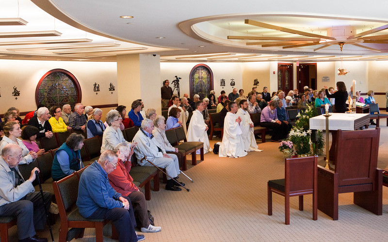 Father Joseph Mozer celebrates a Mass at the Archdiocese of Boston's Pastoral Center in Braintree April 16, 2013 for healing and reconciliation in the wake of the Boston Marathon bombings.  After the Mass,  there was an opportunity for prayer and adoration.<br /> Pilot photo by Gregory L. Tracy