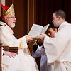 Cardinal Sean P. O'Malley ordains Anthony Cusack, Andrea Filippucci, Christopher Lowe, Peter Stamm, and Sinisa Ubiparipovic transitional deacons at the Cathedral of the Holy Cross Jan. 10, 2015.<br /> Pilot photo/ Gregory L. Tracy