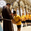 Students from the parish school of Immaculate Conception Parish in Lowell, Mass. venerate the relic of the heart of St. Padre Pio Sept 21, 2016. Their parish was the first stop of a three-day visit of the relic to Boston.<br /> Pilot photo/ Gregory L. Tracy