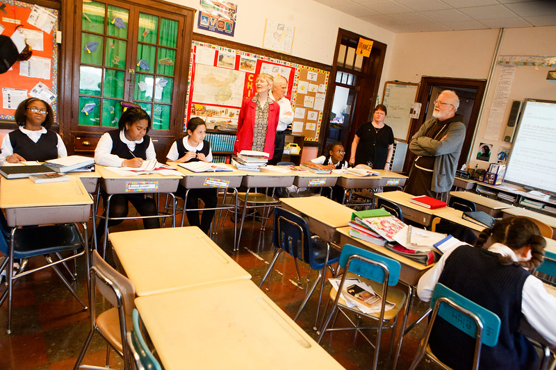 Cardinal Sean P. O'Malley joins archdiocesan employees working to beautify St. Patrick Church in Roxbury as part of Parish Service Week, May 13, 2013. After the spring cleaning, Cardinal Sean visited St. Patrick School spending time with students and with the classmates of Barry Brinson, a 7th grade student at the school who was killed May 9 in a traffic accident in Allston.<br /> Pilot photo by Gregory L. Tracy