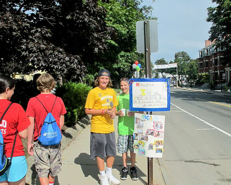 Summer religious education students of St. Peter Parish in Plymouth put their faith into action with a fresh take on the classic lemonade stand, Aug. 7, displaying a Bible, a crucifix, and rosary beads as they shared their faith and free lemonade with passersby while asking for donations to support the Missionary Childhood Association. <br /> Pilot photos/ Courtesy St. Peter Parish
