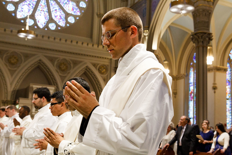 CARDINAL ORDAINS 8 PRIESTS FOR BOSTON