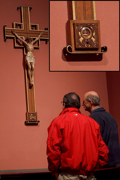 Men venerate the relic of true cross in chapel of Boston's Cathedral  of the Holy Cross in April.  The reliquary containing the piece of Christ's cross, shown in detail in the inset, was discovered stolen July 1.<br /> <br /> Pilot file photo/ Gregory L. Tracy