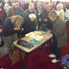 Massgoers view the time capsule contents.<br /> Courtesy photo