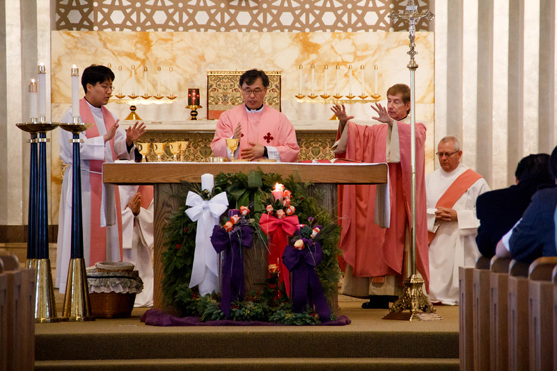 At a morning Mass at Corpus Christi Church on Dec. 11, 2016 parishioners of Corpus Christi-St. Bernard Parish in Newton and members of the Catholic Korean Community witness the signing of a document that transferred the property of Corpus Christi Church to the recently created St. Antoine Daveluy Parish. <br /> Pilot photo/ Mark Labbe