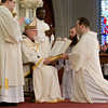 Cardinal Seán P. O'Malley ordains transitional Deacons Eric Cadin, Felipe Gonzalez, Matthew Guidi, John Healy, John Luong, Adrian Milik and Michael Sheehan FPO, Jan. 21, 2012  at Boston's Cathedral of the Holy Cross. Pilot photo by Gregory L. Tracy