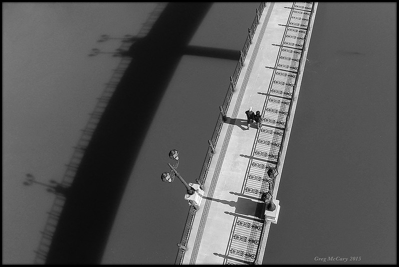 """Couple Crossing a Bridge"" by Cosmonaut"