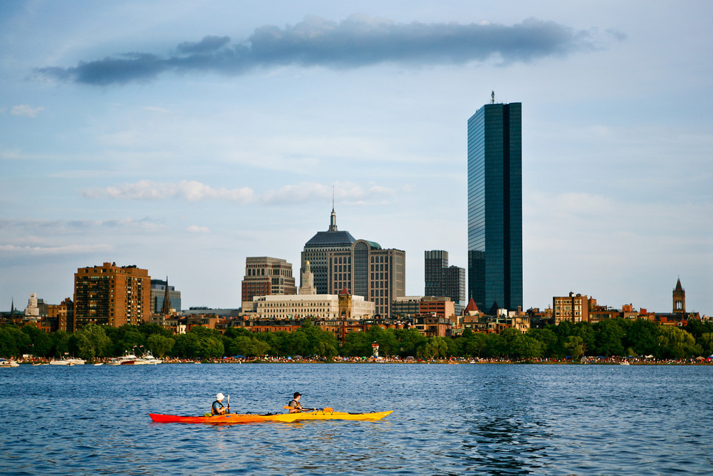 JULY 2011<br /> <br /> Charles River (Cambridge, MA)<br /> <br /> These adventurous kayakers were perfectly positioned for the golden setting sun to illuminate their yellow / orange vessels.   Perfect July evening...