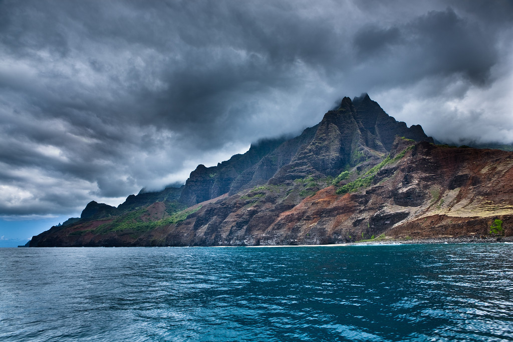 OCTOBER 2012<br /> <br /> Na Pali Coast, Kauai, HI<br /> <br /> This was taken in one of the most isolated and beautiful places I've ever been.  The Na Pali Coast is located on the Northwest part of Kauai.  A deliciously rich landscape full of  wild coastline, unforgiving cliffs, crystal clear ocean, countless waterfalls, and diverse marine life.  A dramatic union of the ocean, mountains and sky...