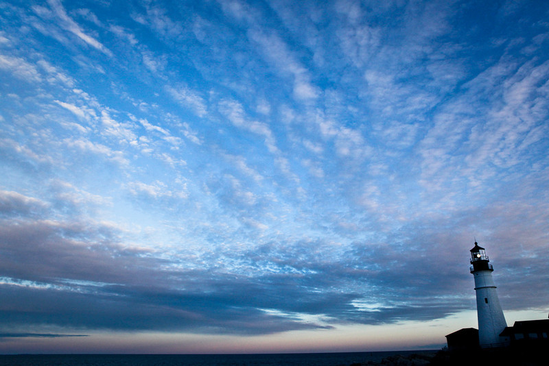 JANUARY 2012 <br /> <br /> Cape Elizabeth, ME<br /> <br /> I arrived at the Portland Head Light at dusk (Cape Elizabeth, ME).  The light was fading fast so I quickly positioned myself to include the vast sky in my shot. I like to find an image that conveys hope and renewal for the month of January.