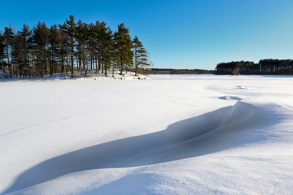 FEBRUARY 2013<br /> <br /> Spot Pond, Medford, MA<br /> <br /> After the Blizzard of 2013, I was quick to dust off my snowshoes and enjoy the fresh powder.  I liked this shot because you can see how the wind created beautiful designs in the snow drifts... I'm probably one of the few New Englanders that hopes for more snow before the Spring!