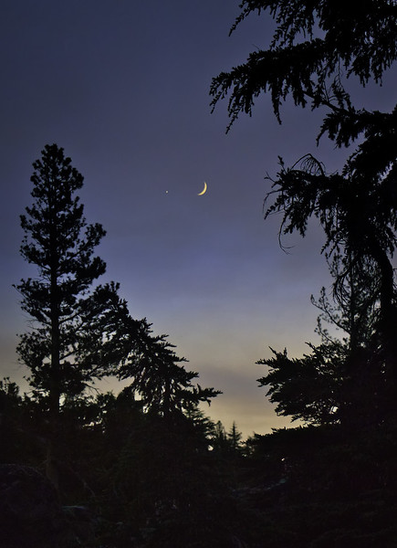 A Crescent Moon and Jupiter sit above the setting sun at Emigrant Lake