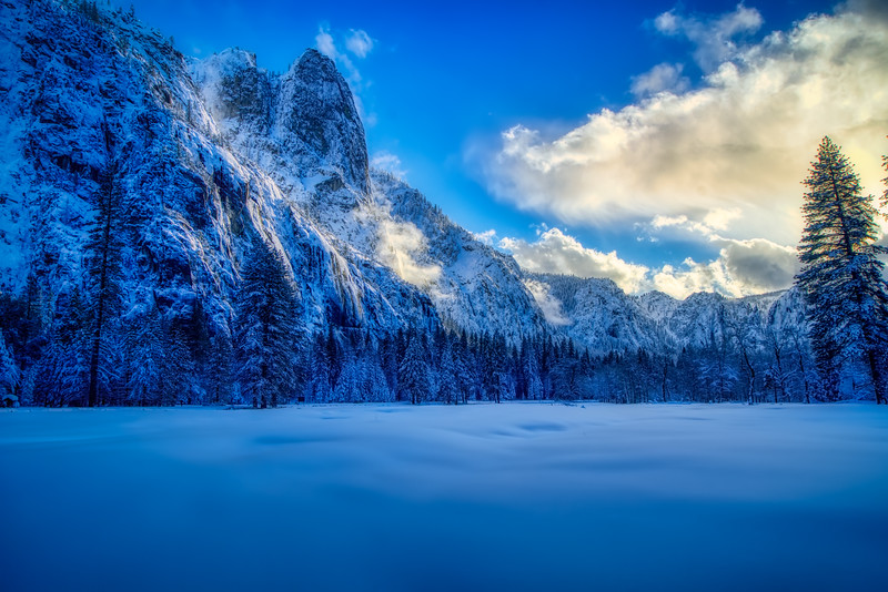 A snow covered Yosemite Valley at sunset