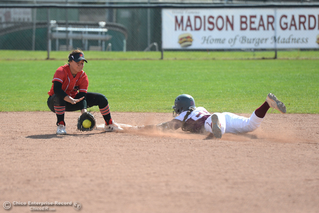 . Chico State\'s Kristin Worley, right, steals second as she beats the throw to Cal State Stanislaus second baseman Belle Placencia, left, Chico State plays Friday, March 10, 2017, against Cal State Stanislaus in Chico, California. (Dan Reidel -- Enterprise-Record)