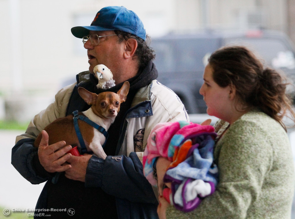 . Danny Gifford tries to check his bird Snuggles and friend\'s dog Junior into the animal shelter February 13, 2017 at the Silver Dollar Fairgrounds in Chico, California. (Emily Bertolino -- Enterprise-Record)