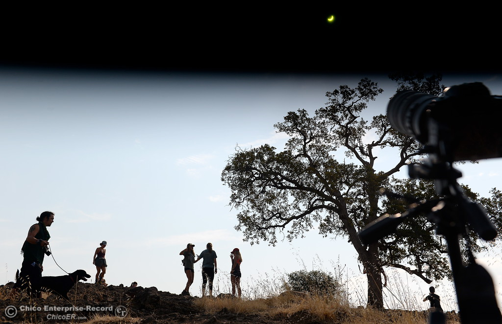 . Several photographers, dogs and hikers check out the solar eclipse from Monkey Face in Upper Bidwell Park in Chico, Calif. Mon. Aug. 21, 2017. (Bill Husa -- Enterprise-Record)