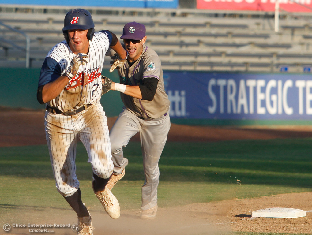 . Chico Heat\'s Carson McCusker tries to out run the tag out from Yuba City Bears\'s Josh Winkler but doesn\'t make it home Wednesday July 19, 2017 at Nettleton Stadium  in Chico, California.  (Emily Bertolino -- Enterprise-Record)