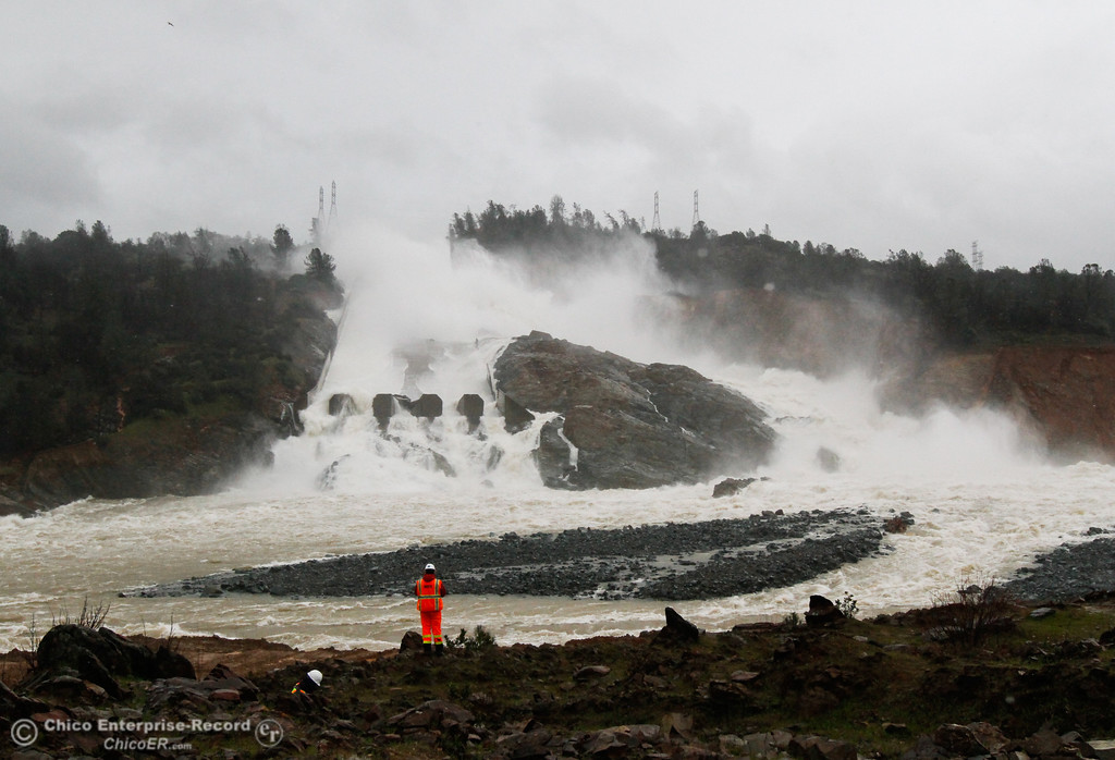 . Crews prepare to clear away the debris that\'s building up at the base of the Oroville Dam Spillway February 20, 2017 in Oroville, California. (Emily Bertolino -- Mercury Register)
