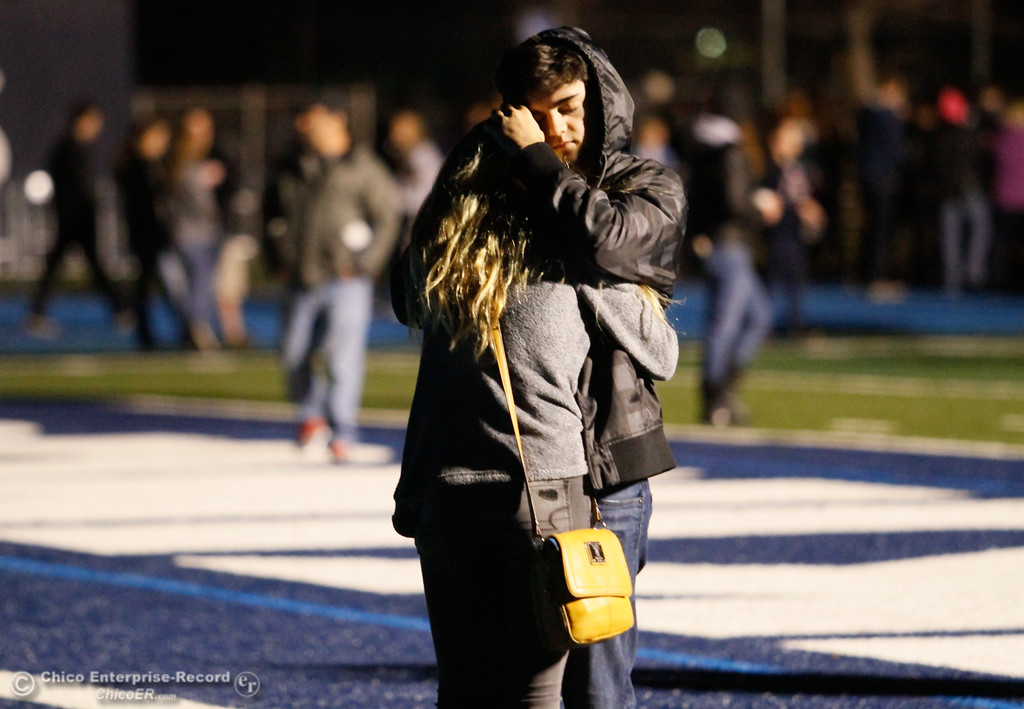 . A couple embraces during a candlelight vigil honoring Pleasant Valley High School teacher and varsity girls soccer coach Brett Silva, who died in a head-on car collision on Highway 32 Sunday, is held Tuesday, January 24, 2017 at the high school in Chico.  (Emily Bertolino -- Enterprise-Record)