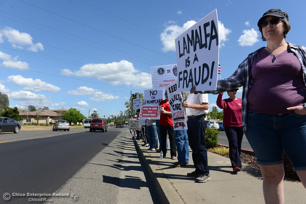 . Liz Michelena, right, and more than 70 others protestors wave signs and chant Friday, May 12, 2017, outside U.S. Representative Doug LaMalfa\'s office in Oroville, California. (Dan Reidel -- Enterprise-Record)